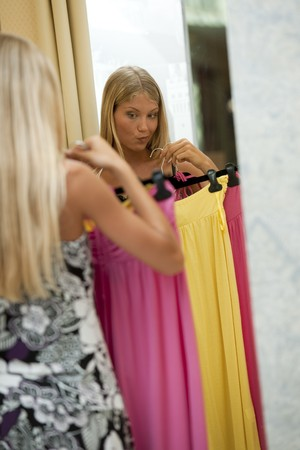 Young woman trying dress on Stock Photo - 7645050