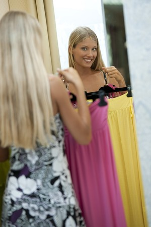 Young woman trying dress on Stock Photo - 7645058