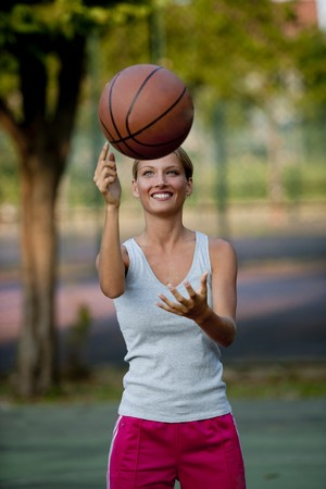Young athlete spinning basketball photo