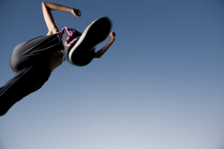 sports clothing: Athlete jumping over the camera