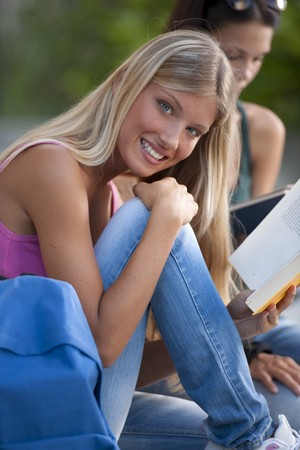 Happy female student students outdoors photo