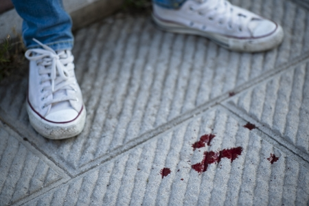 Teenage girl shoes, blood on the pavement photo