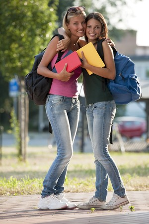 Happy female friends ready for school Stock Photo - 7801530
