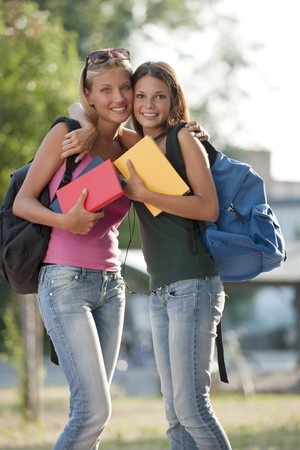 Happy female friends ready for school photo