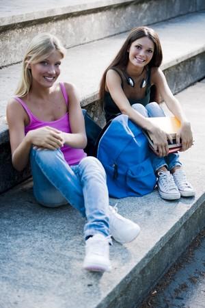 Happy teenage girls with schoolbooks photo