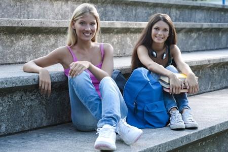 Happy teenage girls with schoolbooks Stock Photo - 7801532