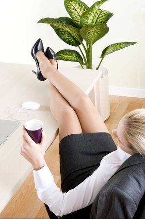 Relaxed businesswoman with legs on the desk Stock Photo - 7815977