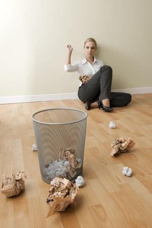 BoredTired businesswoman sitting on the floor