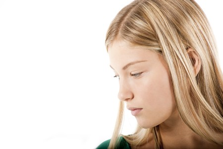 only one girl: Young blond girl in deep thought Stock Photo