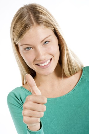 Beautiful teenage girl with thumbs-up, isolated on white photo