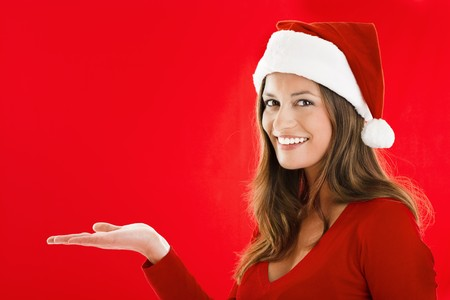 Smiling Santa Girl presenting your product, lots of copy-space photo