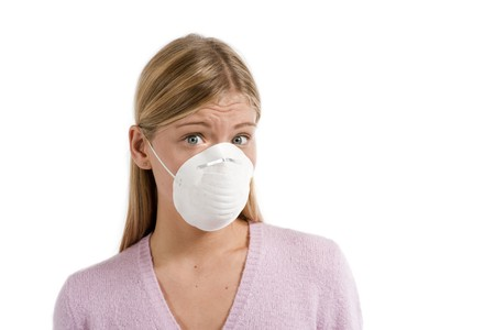 swine flu: Young woman with protecting mask Stock Photo