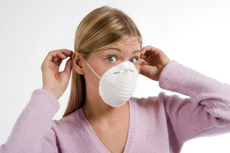 ah1n1: Young woman with protecting mask Stock Photo