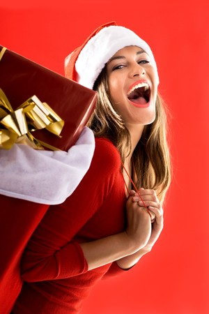 Excited Santa Girl carrying gifts Stock Photo - 7941059