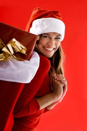 Cheerful Santa Girl carrying gifts photo