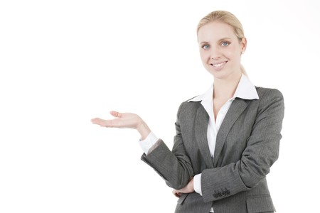 Attractive Businesswoman Presenting a Product Stock Photo - 7941033