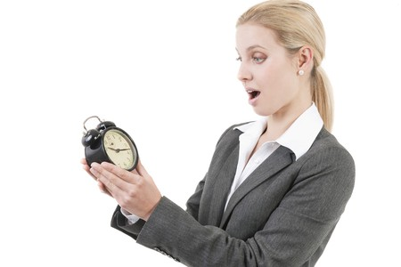 Businesswoman looking shocked at the clock Stock Photo - 7941055