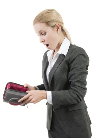 Shocked woman looking into her empty wallet photo