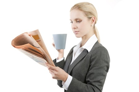 Relaxed businesswoman with coffee and newspaper Stock Photo - 7941037