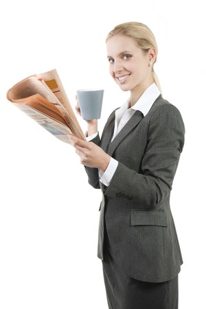 Relaxed businesswoman with coffee and newspaper Stock Photo - 7941048