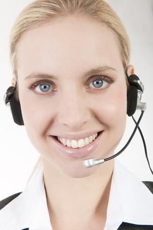 Businesswoman talking on headphones Stock Photo - 7941053