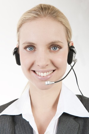 Businesswoman talking on headphones photo