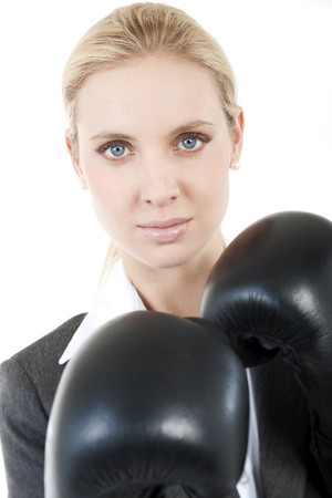Businesswoman with boxing gloves photo