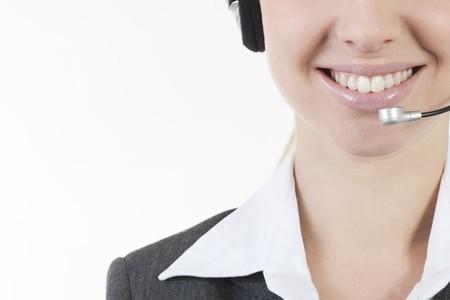 Businesswoman talking on headphones Stock Photo - 7941024