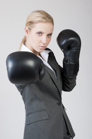 females only: Businesswoman with boxing gloves Stock Photo