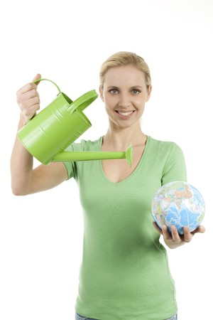 life saving: Young woman watering the Earth; conepts: lack of water, giving life, saving