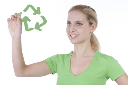 Young woman drawing recycling symbol on copy space photo