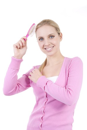 Blond woman with hairbrush photo