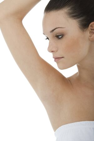 armpit hair: Young woman looking at her clean armpit Stock Photo
