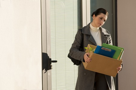 downsizing: Young businesswoman losing her job due to corporate downsizing