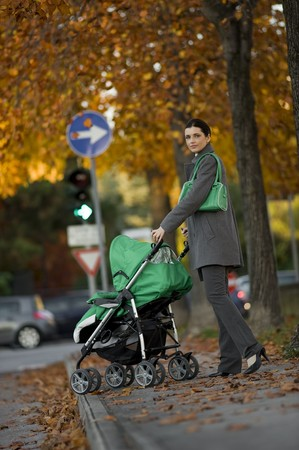 Young woman walking her child through the city photo