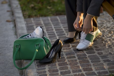 Young businesswoman changing shoes photo