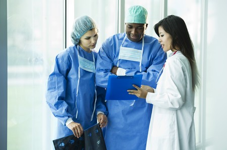 Doctor and surgeons consulting Stock Photo - 8180377