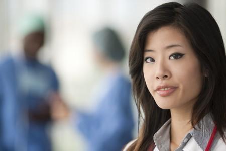 Chinese female doctor, surgeons on backgrounds Stock Photo - 8182166
