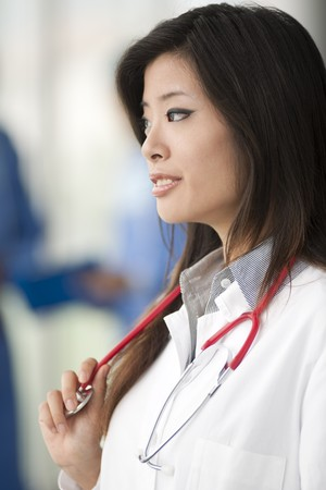 Chinese female doctor, surgeons on backgrounds Stock Photo - 8182181