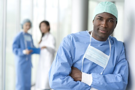 Portrait of a male surgeon, colleagues on background photo