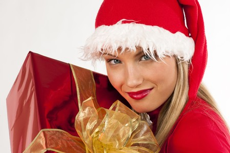 Rich, colorful series of attractive young woman in santas hat with presents photo