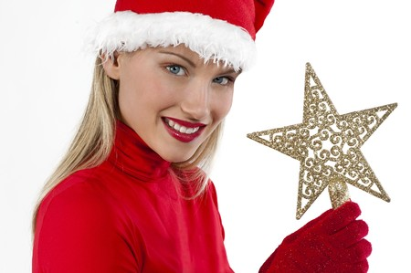 Beautiful Santa girl on white holding a Christmas decoration photo