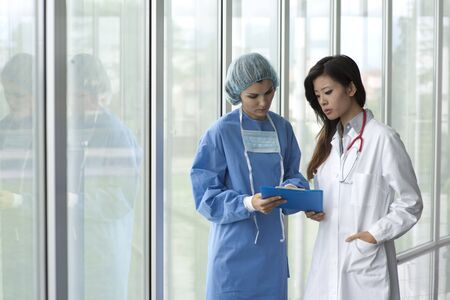 Female doctor and surgeon consulting Stock Photo - 8182334