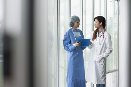 Female doctor and surgeon consulting Stock Photo - 8180511