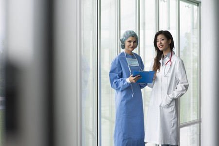 Female doctor and surgeon consulting Stock Photo - 8180521