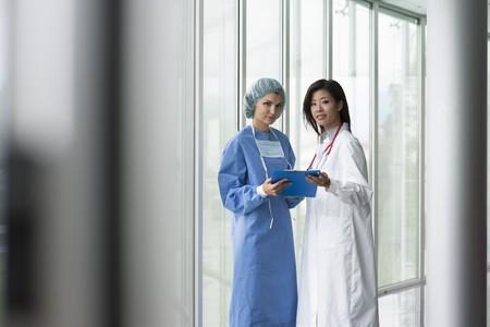 Female doctor and surgeon consulting Stock Photo - 8180508