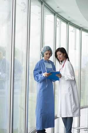 Female doctor and surgeon consulting Stock Photo - 8180519