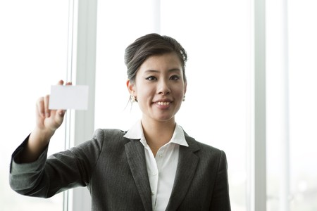 businesscard: Chinese BUsinesswoman holding a blank businesscard