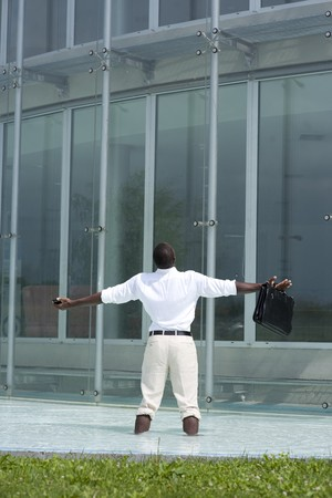 Businessman in the pool outside his office;  he could be excited beacuse he has just resigned photo