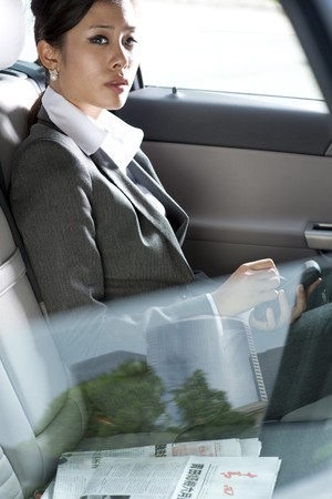 Young chinese business woman inside a car photo